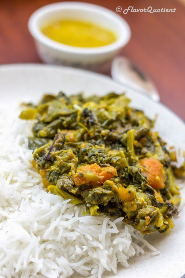 Ilish macher matha diye pui shaak which can be perfectly translated as Malabar spinach with Hilsa head – a typical recipe from Bengal, my hometown, which proves the extent of our love for fish!