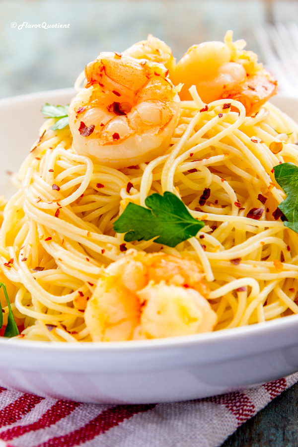 Shrimp Scampi with Capellini | Flavor Quotient | Shrimp scampi in the lemon-wine sauce served on top of capellini or angel hair pasta will be the best summer pasta you ever had.