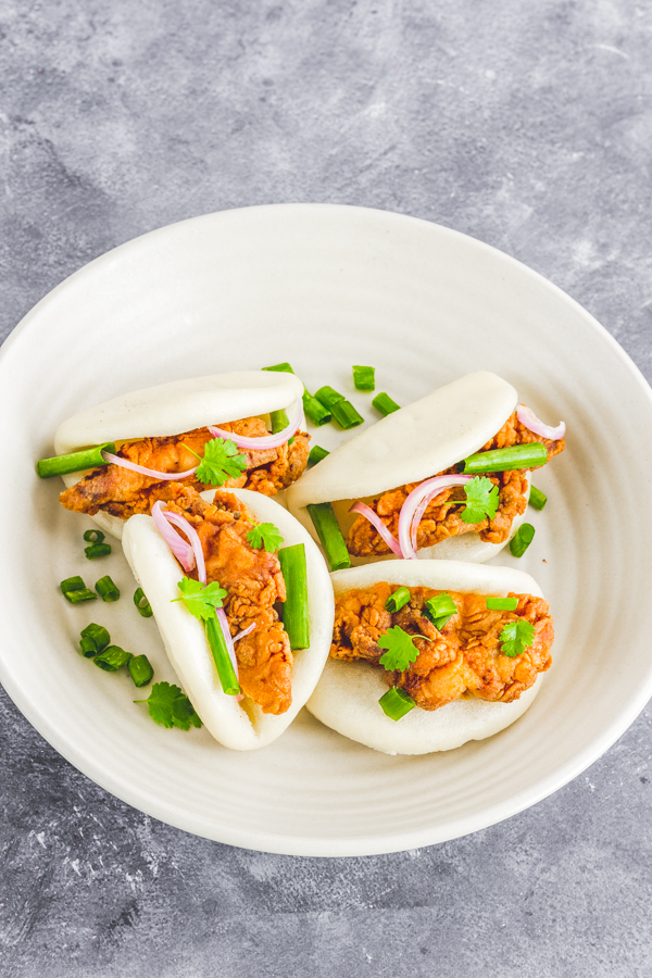 Classic Chinese Bao buns with crispy fried chicken – the ultimate showstopper! Sharing my fail-proof recipe of this stunner called bao buns stuffed with crispy chicken drizzled with spicy mayo! | bao buns recipe | Chinese bao buns | Recipe how to make bao buns | bao buns filling | Steamed bao buns | Chicken bao buns | How to make bao buns | Homemade bao buns | crispy chicken bao buns | bao buns filling recipe | korean chicken bao buns | Taiwanese burger