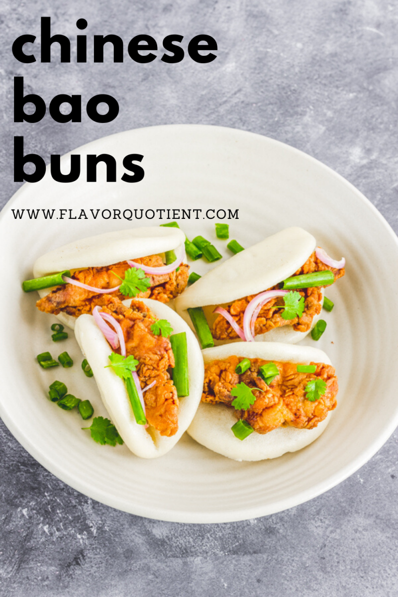 Classic Chinese Bao buns with crispy fried chicken – the ultimate showstopper! No, it's not a restaurant's menu card but I'm sharing my fail-proof recipe of this stunner called bao buns with crispy chicken! The spicy fried chicken wrapped inside the soft steamed baos bring in ultimate pleasure to your taste buds!   chinese bao buns   steamed bao   Taiwanese burger   bao bun with chicken   chicken bao   bao in steamer basket   how to make bao bun