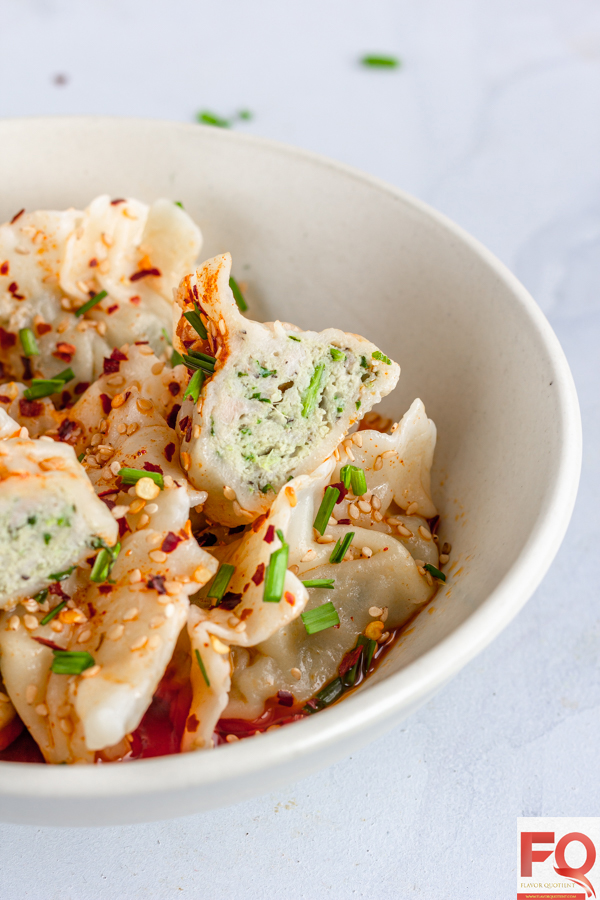 This bowl full of Sichuan chicken dumplings drizzled with spicy red sauce is simply pure culinary heaven! Once you make your own Sichuan spiced chicken dumplings at home, you will forget even the fine diners! | Easy Chicken Dumplings | Chicken Dumplings recipe | Sichuan Chicken Dumplings | Chinese Chicken Dumplings | Homemade Chicken Dumplings | Asian Chicken Dumplings | How to make Chicken Dumplings | Steamed Chicken Dumplings | Chicken Dumplings Filling